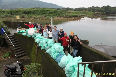 Faculty and students after a hard day of cleaning the local beach
