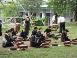 Student and other members of the community getting ready for a performance