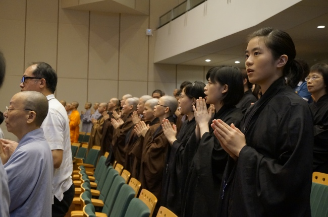 Students wearing the traditional black Haiqing (海清) for a graduation ceremony
