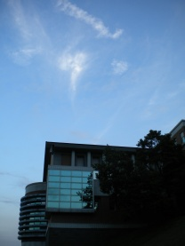 exterior view of the college's conference hall at dusk