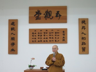 President Huimin (惠敏校長) giving a speech after the end of a retreat