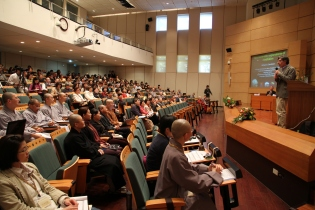 Prof. Richard Davidson speaking at a conference on science and meditation in the college's conference hall