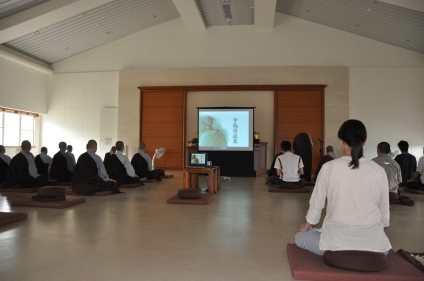 Watching an instruction DVD by master Sheng Yen during a one-day retreat